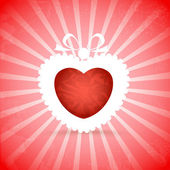 Red heart on red background with rays — Stock vektor
