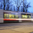 Stock Photo: Fast moving tram in the evening