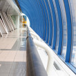 Handrail in long corridor of airport — Foto Stock