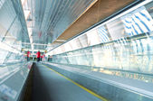 Metro escalator in glass corridor — Stock Photo