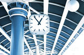 Clock on the column of transport station — Stock Photo