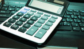 Calculator and money — Stockfoto