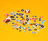 Background of letters on yellow — Stock Photo