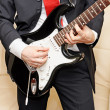 Businessman playing guitar — Stock Photo