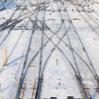 Train tracks at the train depot in winter snowfall - Stock fotografie