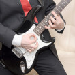 Royalty-Free Stock Photo: Businessman playing guitar