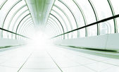 Long bright corridor with the light in the end — Stock Photo