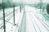 Train tracks at the train depot in winter snowfall — Stock Photo