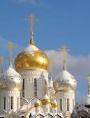Shining domes of white church — Stock Photo