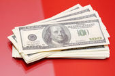 Dollars on red background — Stock Photo