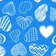 Seamless background of hearts on blue — Stock Vector #8461809