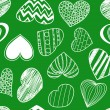 Seamless background of hearts on green — Stok Vektör #8461813