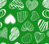 Seamless background of hearts on green — Vector de stock