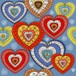 Ornamented color hearts seamless background — ストックベクタ