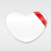 White paper heart with red ribbon — Stockvektor