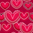Valentine red hearts seamless background — Imagen vectorial