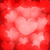 Valentine`s red hearts background — Stock Vector