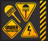 Under construction. Grunge signs with the lighting and spade — Stock Vector