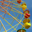 Stock Photo: Colorful ferris wheel and blue sky