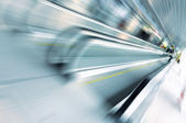 Abstract motion of escalator in glass corridor — Stock Photo