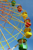 Colorful ferris wheel and blue sky — Stock Photo