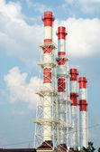 Red and white tubes, blue sky and clouds Red and white tubes, blue sky and clouds — Stock Photo