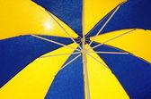 Colorful sun umbrella background — Stock Photo