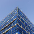 Stock Photo: Corner of blue scaffolding