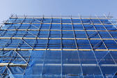 Blue scaffolding and blue sky — Stock Photo