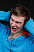 Shouting teenager listens music — Stock Photo