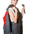 Girl in coveralls with spanner — Stock Photo