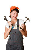 Smiling girl with hammer and spanner — Stock Photo