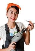 Überrascht Mädchen mit Werkzeugen — Stockfoto