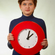 Surprised girl with clock — Stock Photo #8974196