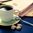 Coffee and newspaper - Stock Photo
