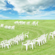Chairs in grass — Stock Photo