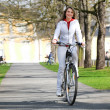 Stock Photo: Girl walks city with bicycle