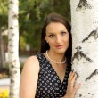 The beautiful girl in a black dress at a tree — Stock Photo #9550080