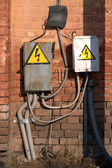 The electric equipment on an ancient brick wall — Stock Photo