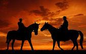 Silhouette cowboys — Stock Photo