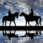 Silhouette cowboys — Stock Photo #10343471