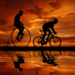 Stock Photo: Silhouette cyclists