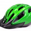Green bicycle cross country plastic helmet - Stock Photo