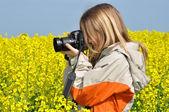 Girl taking photos — Stock Photo