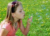 Girl with a bubble blower — Stock Photo