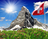 Matterhorn with Swiss flag - Swiss Alps — Stock Photo