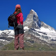 Girl looking at the beautiful Mount Matterhorn - Stock Photo