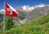 Mountain Ober Gabelhorn with Swiss flag — Stock Photo