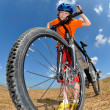 Portrait of a girl with bike — Stock Photo