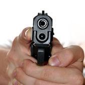 Gun in hand — Stock Photo
